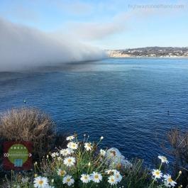 Fog in La Jolla barreling towards the shore.