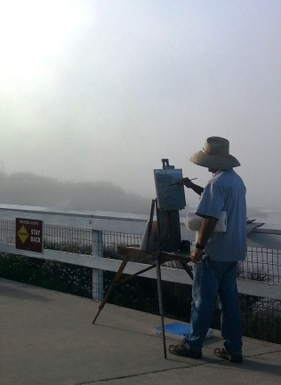 The artist continues to paint through the fog.