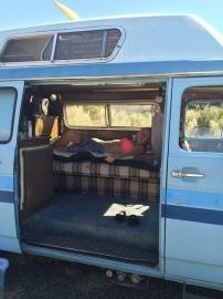 Kim relaxes in the van