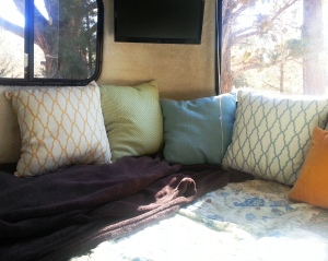 The interior of our Casita trailer, looking out at beautiful scenery.