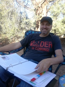 Mike, reading at our campsite.